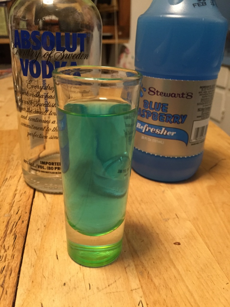 The only thing green about this drink is the shot glass.